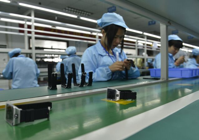 This picture taken on April 22, 2015 shows Chinese workers assembling a cheaper local alternative to the Apple Watch in a factory producing thousands every day in Shenzhen, in southern China's Guangdong province.  The much-hyped Apple Watch goes on sale on April 24, but Chinese factories are already churning out cheaper alternatives to the apparent delight of local consumers