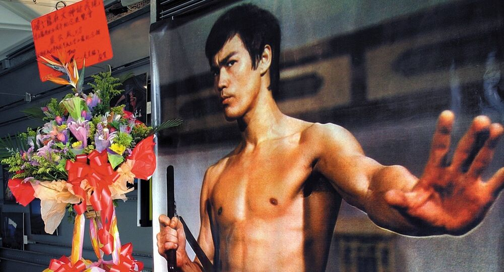 A giant poster of kung fu legend Bruce Lee during an exhibition at Hong Kong's Art center marking the 30th anniversary of Lee's death in this Wednesday, July 16, 2003