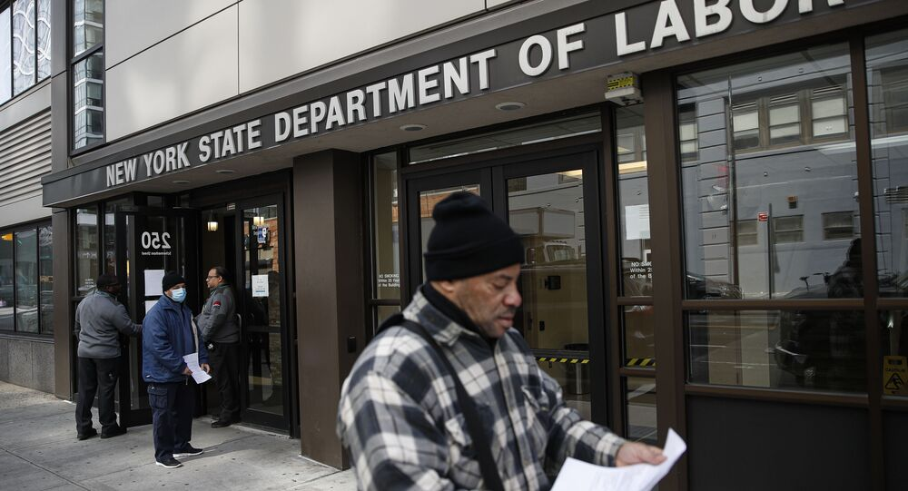 In this March 18, 2020 file photo, visitors to the Department of Labor are turned away at the door by personnel due to closures over coronavirus concerns in New York