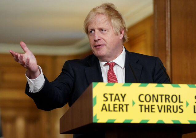 A handout image released by 10 Downing Street, shows Britain's Prime Minister Boris Johnson, standing behind a podium featuring the Government's new slogan Stay Alert, Control the Virus, Save Lives, as he attends a remote press conference to update the nation on the COVID-19 pandemic, inside 10 Downing Street in central London on May 11, 2020. - The British government on Monday published its plan to ease the nationwide coronavirus lockdown in phases in England, with some schools and shops opening from June and recommending people wear face masks in some settings.