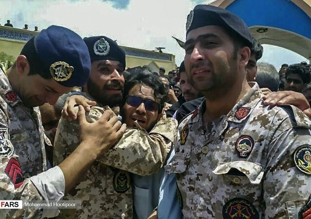 Iranian troops mourn their fallen comrades following Sunday's apparent friendly fire naval incident. Tuesday, May 12, 2020.