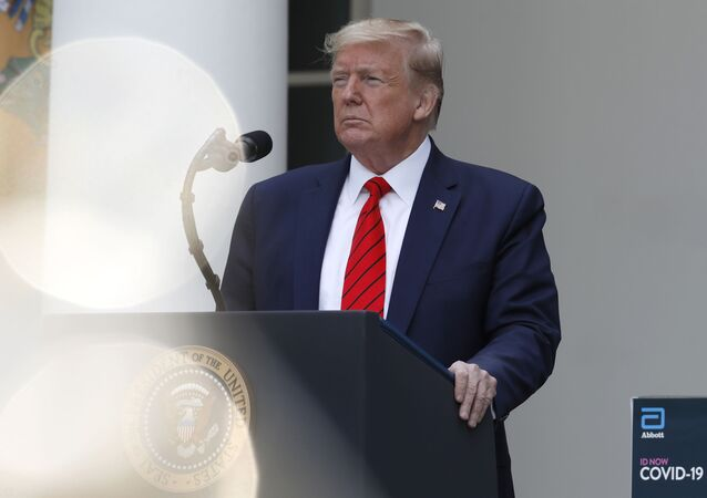 President Donald Trump listens during a briefing about the coronavirus in the Rose Garden of the White House, Monday, May 11, 2020, in Washington