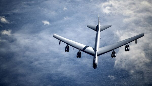 A U.S. Air Force B-52 Stratofortress breaks away from a KC-135 Stratotanker from the 100th Air Refueling Wing, RAF Mildenhall, England, after receiving fuel during a strategic bomber mission, May 7, 2020. - Sputnik International