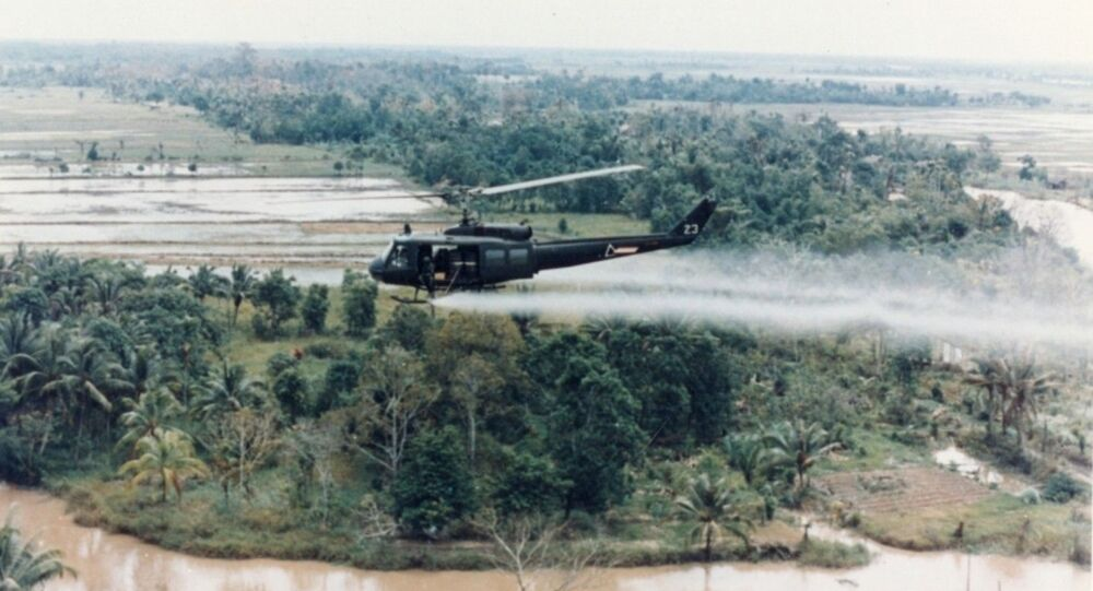 U.S. Huey helicopter spraying Agent Orange over Vietnam