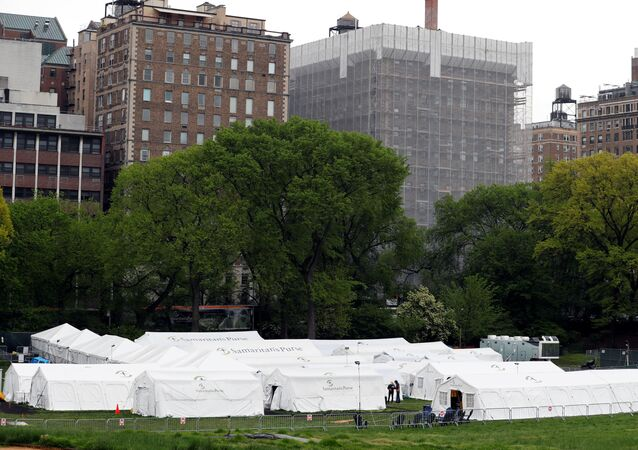 People walk near the Samaritan's Purse Emergency Field Hospital in Central Park as the outbreak of the coronavirus disease (COVID-19) continues in the Manhattan borough of New York U.S., May 8, 2020