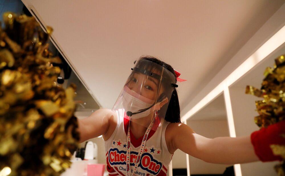 Cheerleader waitress at Cheers One restaurant in Tokyo