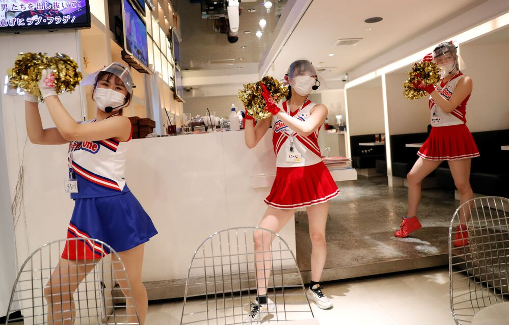 Cheerleaders waitresses at the Cheers One restaurant in Tokyo