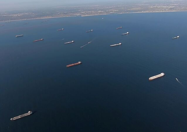 Some of the 27 oil tankers anchored off shore during the outbreak of the coronavirus disease (COVID-19) are viewed from a U.S. Coast Guard helicopter near Long Beach, California, U.S., in a still image from video taken April 23, 2020