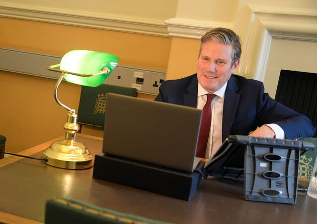 Britain's opposition Labour Party Leader Keir Starmer is seen in his office as he launches 'Call Keir' online public meetings, at the Houses of Parliament, following the outbreak of the coronavirus disease (COVID-19), in London, Britain, April 30, 2020