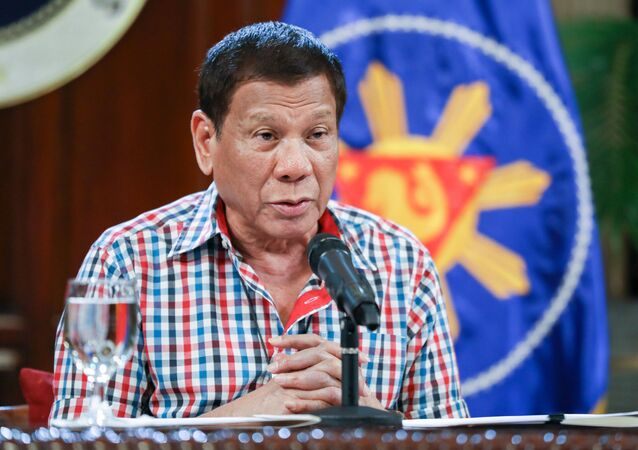 In this April 16, 2020, photo provided by the Malacanang Presidential Photographers Division, Philippine President Rodrigo Duterte speaks to the nation about the government's efforts to prevent the spread of the coronavirus that causes the COVID-19 disease during a televised address from Malacanang palace in Manila, Philippines