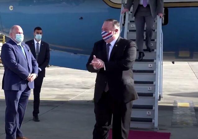 Wearing U.S.-flag face mask, Pompeo visits Israel