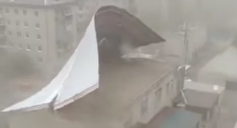 Screengrab from amateur video showing winds ripping steel building off roof in Chita, Siberia on Wednesday, May 12, 2020.