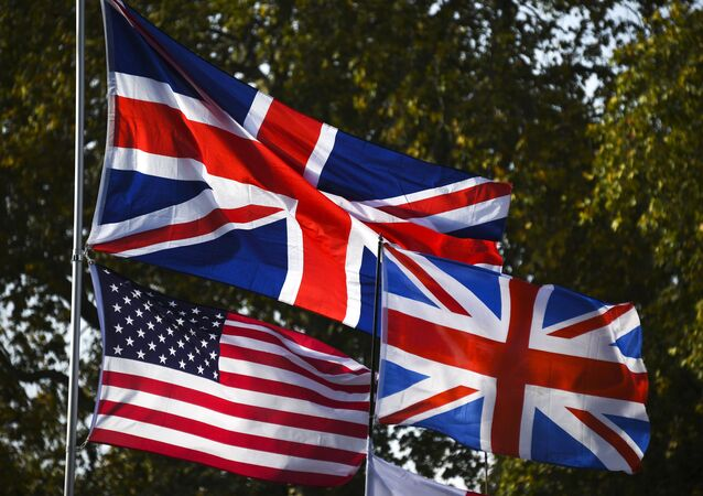 Union and U.S. flags wave outside the houses of Parliament, in London, Thursday, Oct. 31, 2019