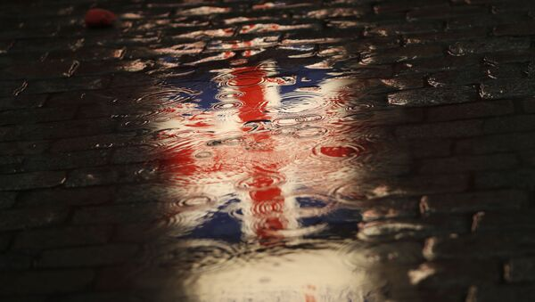 The Union flag is reflected in a puddle during an event called Brussels calling to celebrate the friendship between Belgium and Britain at the Grand Place in Brussels, Thursday, Jan. 30, 2020 - Sputnik International