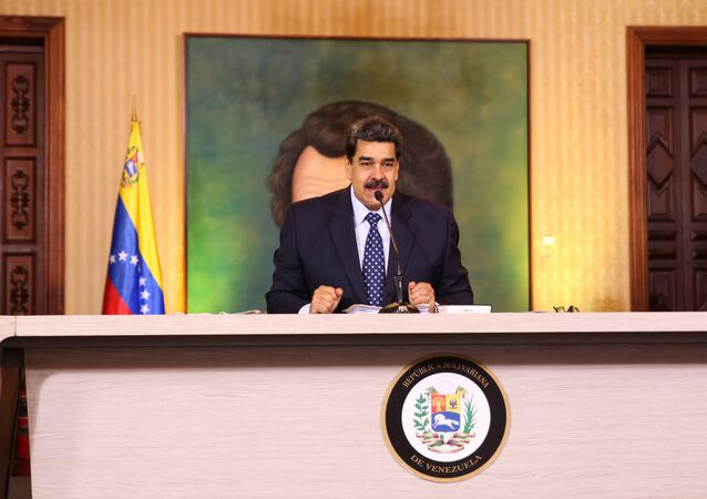 Handout picture released by the Venezuelan Presidency showing Venezuelan President Nicolas Maduro speaking during a video conference meeting with international media correspondents, at Miraflores Presidential Palace in Caracas, on May 6, 2020.