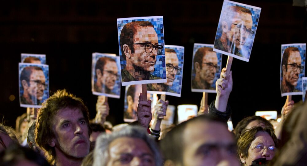 People hold up photographs of murdered Argentinian journalist and writer Rodolfo Walsh during a Dirty War trial in Buenos Aires.