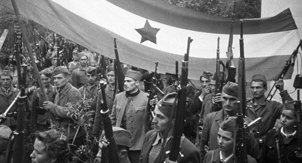 Yugoslav guerrillas carrying a banner