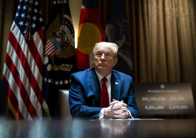 U.S. President Donald Trump looks on he as meets with Colorado Governor Jared Polis and North Dakota Governor Doug Burgum in the Cabinet Room of the White House on May 13, 2020 in Washington, DC.