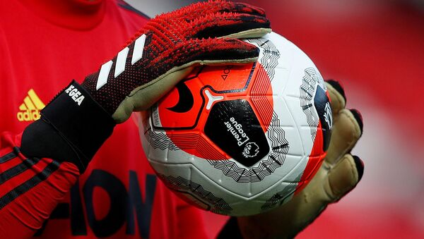 ILE PHOTO: Soccer Football - Premier League - Manchester United v Watford - Old Trafford, Manchester, Britain - February 23, 2020  General view of a match ball held by Manchester United's David de Gea during the warm up before the match - Sputnik International