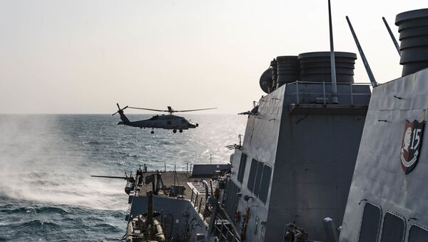 """An MH-60 Sea Hawk helicopter, assigned to the """"Warlords"""" of Helicopter Maritime Strike Squadron (HSM) 51, takes off from the flight deck aboard the Arleigh Burke-class guided-missile destroyer USS McCampbell (DDG 85) while conducting underway operations in support of stability and security for a free and open Indo-Pacific. - Sputnik International"""