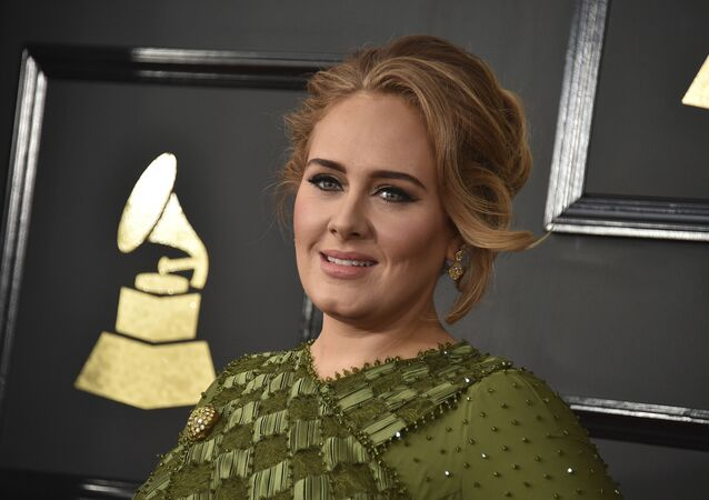 In this Feb. 12, 2017, file photo, Adele arrives at the 59th annual Grammy Awards at the Staples Center in Los Angeles. Adele and her husband Simon Konecki have separated