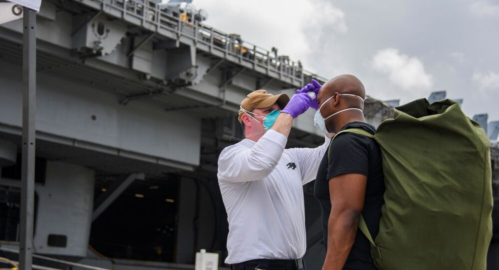 U.S. Navy sailors assigned to aircraft carrier USS Theodore Roosevelt, who have tested negative twice for coronavirus disease (COVID-19), are asymptomatic and completed their off-ship quarantine or isolation, prepare to board the clean ship at Naval Base Guam May 1, 2020