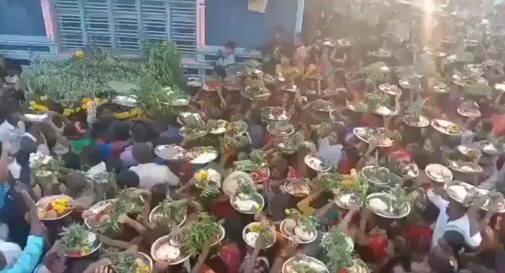 Hundreds of people with no regard for masks or social distancing gather for a village temple fair at Ramanagara district