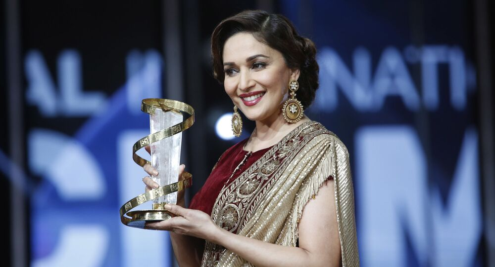 Indian actress Madhuri Dixit holds her award for her contribution to acting, during the 15th Marrakech International Film Festival in Marrakech, Morocco, Saturday, Dec. 5, 2015