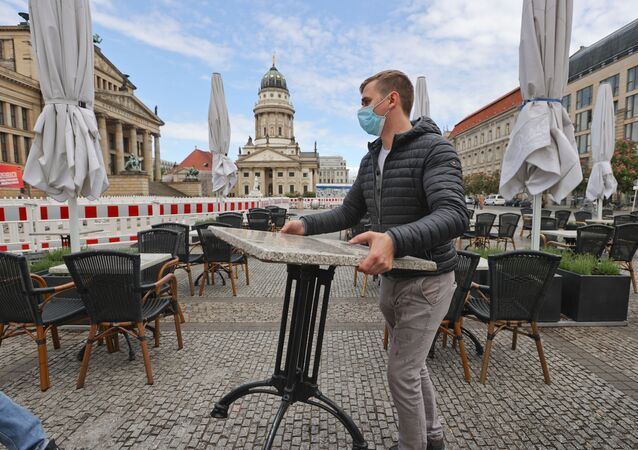 Staff of the restaurant Shan Rahimkahn prepare for the reopening, as the country loosens the coronavirus disease (COVID-19) restrictions at Gendarmenmarkt square in Berlin, Germany, May 14, 2020