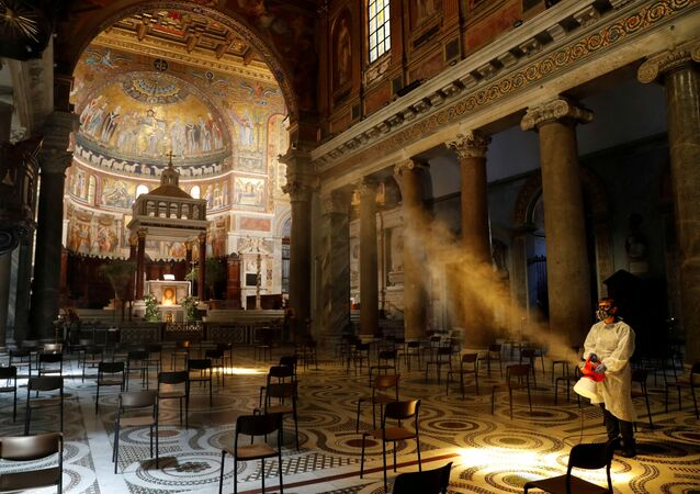 A man disinfects the Santa Maria in Trastevere Basilica, during the coronavirus disease (COVID-19) outbreak, in Rome, Italy, May 11, 2020. REUTERS/Remo Casilli