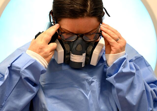 Clinical staff put on Personal Protective Equipment (PPE)  at the Intensive Care unit at Royal Papworth Hospital, during the coronavirus disease (COVID-19) outbreak, in Cambridge, UK 5 May 2020