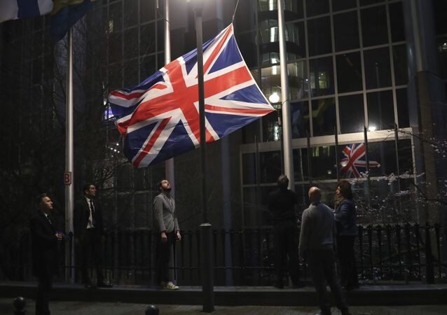 The Union flag is lowered and removed from outside of the European Parliament in Brussels, Friday, Jan. 31, 2020