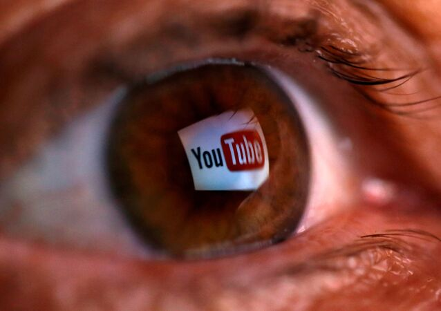 A picture illustration shows a YouTube logo reflected in a person's eye June 18, 2014