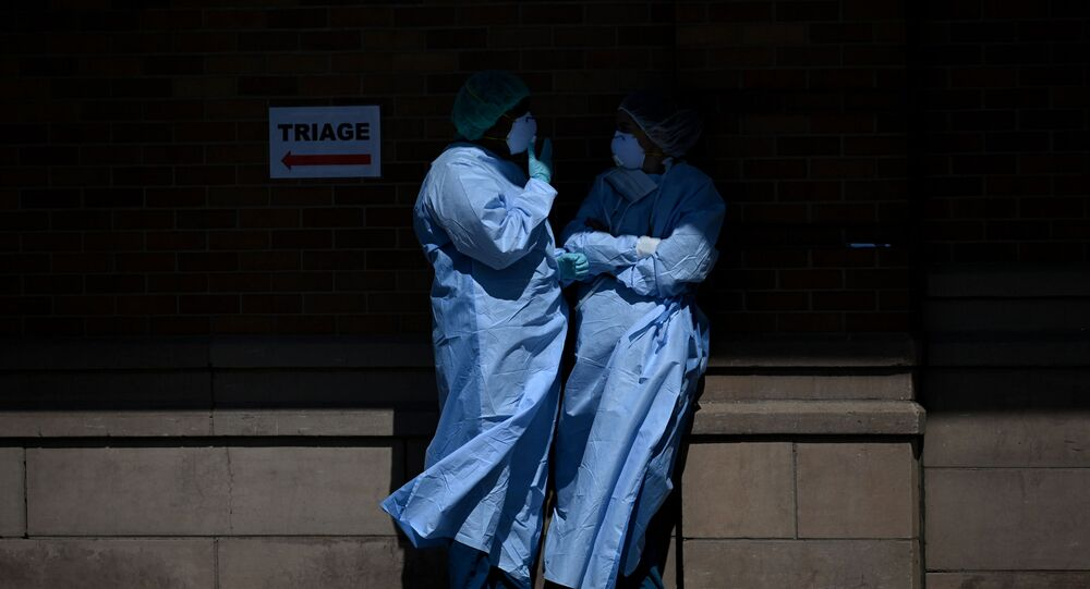 Medical workers take a break outside a special COVID-19 area at Maimonides Medical Center on May 14, 2020 in the Borough Park neighborhood of Brooklyn in New York City