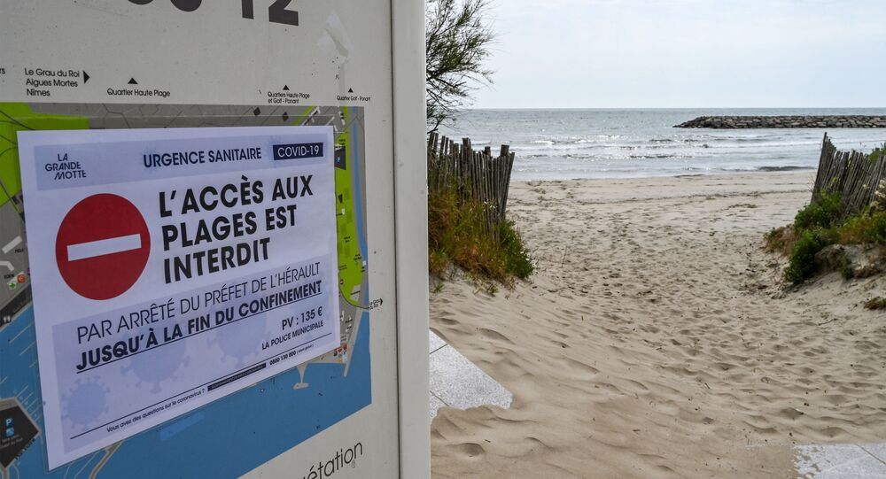 A banner reading access to the beach prohibited is displayed at a deserted beach of La Grande-Motte, south of France, during Easter holidays on April 12, 2020, on the twenty-seventh day of a strict lockdown in France to curb the spread of COVID -19 caused by the new coronavirus
