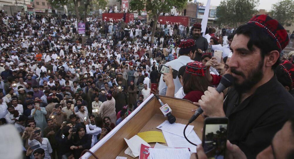 FILE - In this April 22, 2018, file photo, Manzoor Pashteen, a leader of Pashtun Tahafuz (Protection) Movement or (PTM) addresses his supporters during a rally in Lahore, Pakistan