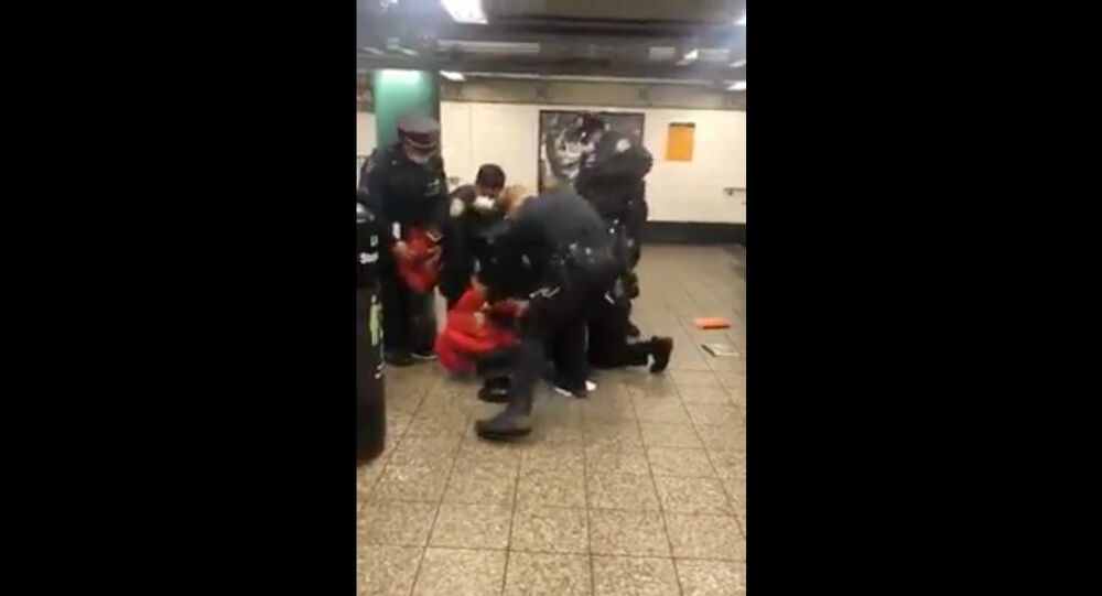 Cellphone footage captures moment multiple NYPD officers arrest woman following confrontation over face mask
