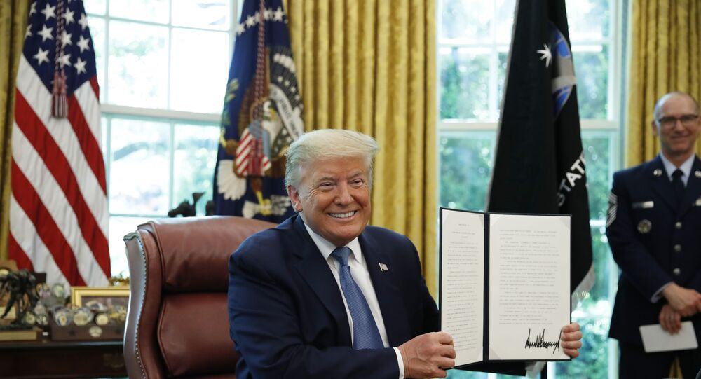 President Donald Trump smiles after signing an Armed Forces Day Proclamation in the Oval Office of the White House, Friday, May 15, 2020, in Washington.
