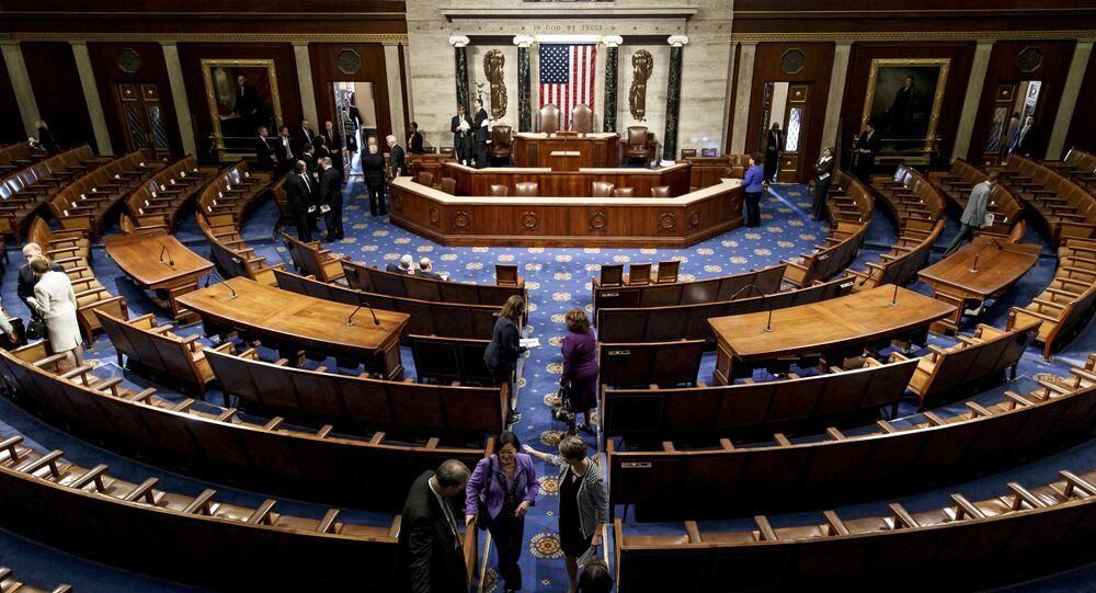 The chamber of the House of Representatives empties following a joint meeting of Congress at the Capitol in Washington, Thursday, 18 September 2014.