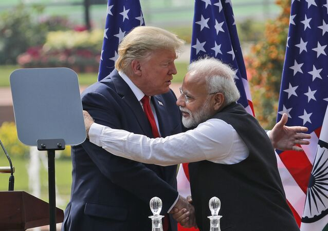 U.S. President Donald Trump and Indian Prime Minister Narendra Modi embrace after giving a joint statement in New Delhi, India, Tuesday, Feb. 25, 2020.