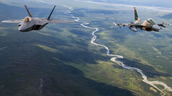 A US Air Force F-22 Raptor from Joint Base Elmendorf-Richardson and an F-16 Fighting Falcon from Eielson Air Force Base fly in formation over the Joint Pacific Alaska Range Complex, July 18, 201 - Sputnik International