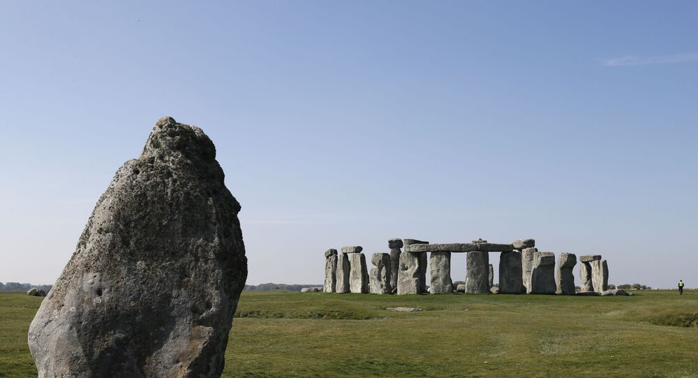 Security guards patrol the prehistoric monument at Stonehenge in southern England, on April 26, 2020, closed during the national lockdown due to the novel coronavirus COVID-19 pandemic