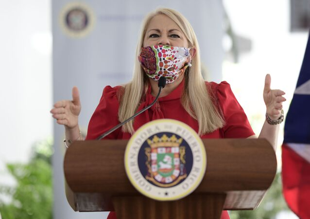 Gov. Wanda Vazquez, wearing a protective face mask, at a press conference in San Juan, Puerto Rico, Thursday, April 16, 2020.