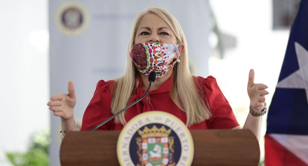 Gov. Wanda Vazquez, wearing a protective face mask, at a press conference in San Juan, Puerto Rico, Thursday, April 16, 2020.