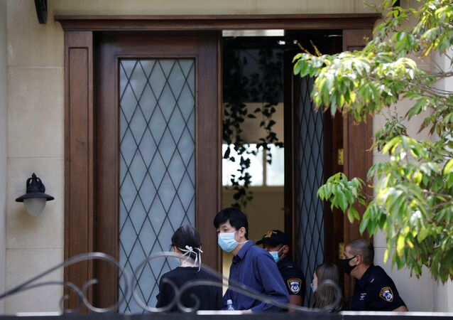 People and Israeli police are seen at the door of China's ambassador to Israel, Du Wei's home in Herzliya, near Tel Aviv, Israel May 17, 2020