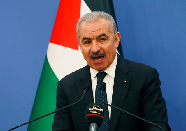 Palestinian Prime Minister Mohammad Shtayyeh speaks before the start of the weekly cabinet meeting in Ramallah in the Israeli-occupied West Bank May 11, 2020.