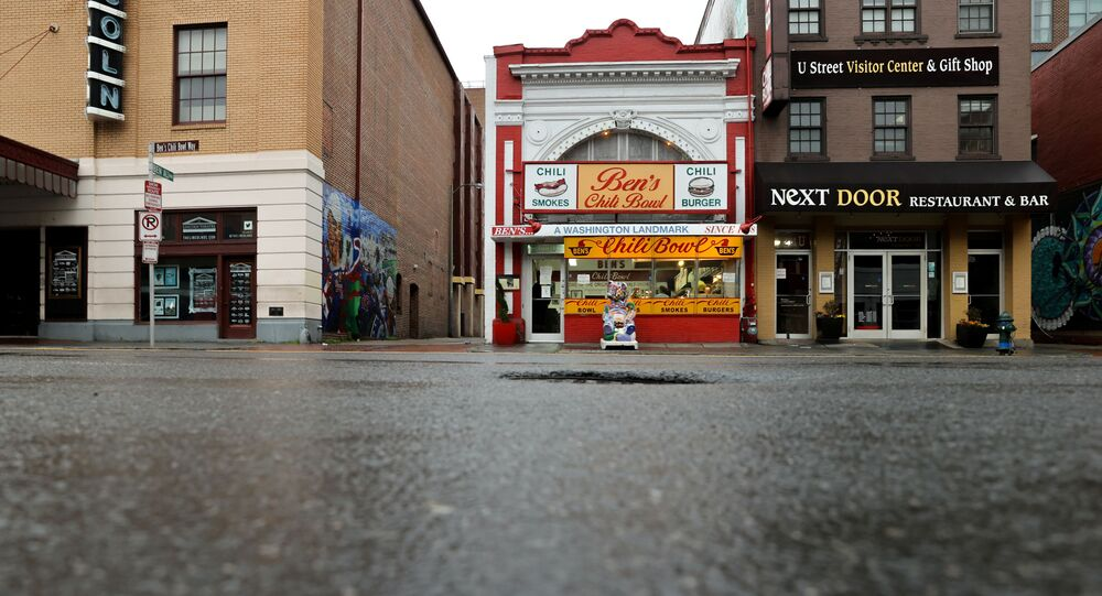 The sidewalk is seen empty during dinner hour at Ben's Chili Bowl, whose founders Ben and Virginia Ali famously kept the restaurant running through very difficult times in the past, as the eatery navigates the coronavirus disease (COVID-19) outbreak with no seating, limited hours and help from a federal Payroll Protection Program Loan in Washington, U.S. April 30, 2020.