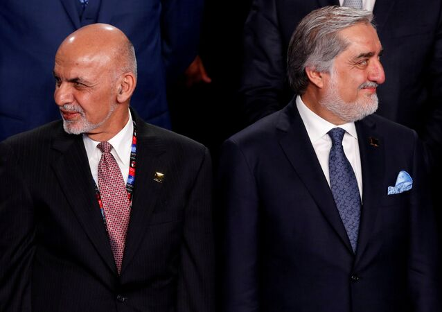 Afghanistan's President Ashraf Ghani (L) and Afghanistan's Chief Executive Abdullah Abdullah (R) participate in a family photo at the NATO Summit in Warsaw, Poland July 8, 2016