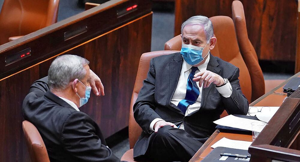 A handout picture released by the Israeli Knesset (parliament) spokesperson's office on May 17, 2020, shows Israeli Prime Minister Benjamin Netanyahu (R) and alternate PM Benny Gantz during the swearing-in ceremony of the new government in Jerusalem.