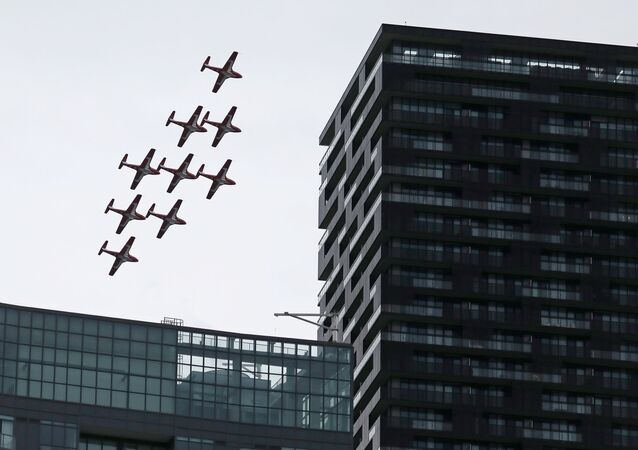 The Canadian Forces' Snowbirds aerobatic team over Toronto, Ontario